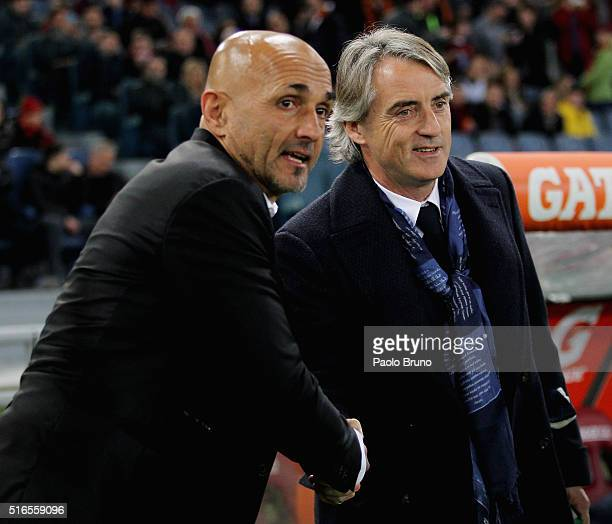 Roma head coach Luciano Spalletti shakes the hand of Roberto Mancini the head coach of FC Internazionale Milano during the Serie A match between AS...