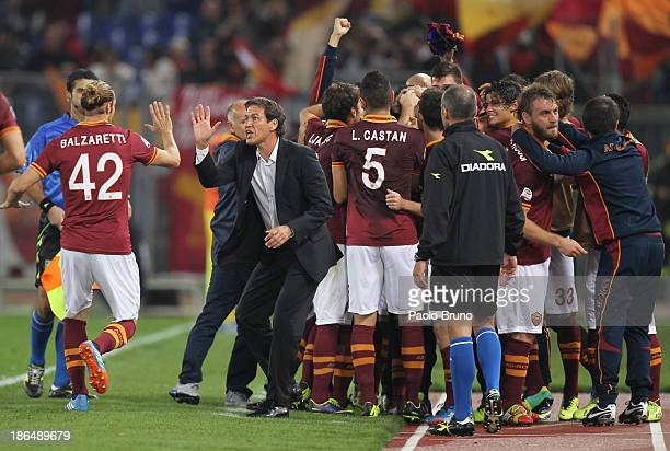 Roma head coach Rudi Garcia with his players celebrates the opening goal scored by Marco Borriello during the Serie A match between AS Roma and AC...