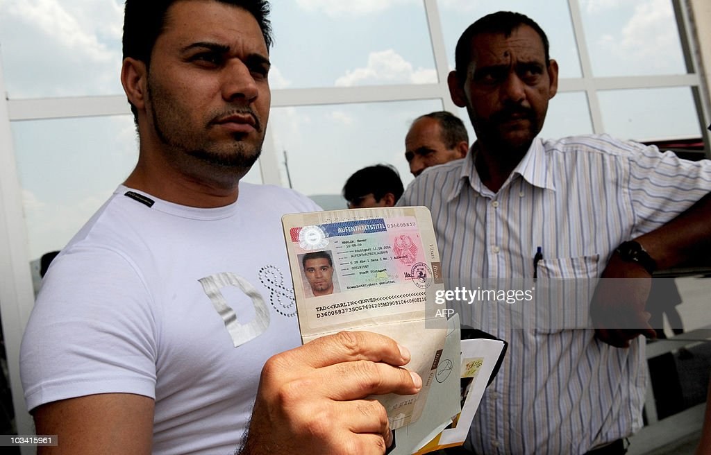 Roma men shows his passport after his arrival at the Pristina airport on July 20, 2010. For Roma kids expelled by Germany, Kosovo is a nightmare. They arrived in Germany in the 1990s fleeing the brutal crackdown on Kosovo by late Serbian strongman Slobodan Milosevic's, which ended with a bloody conflict in 1999. Now they are being sent back Kosovo, which declared independence in 2008 dispite fierce Serbian opposition. Although Pristina agreed with Berlin to admit all Roma refuges from Kosovo, minister for welfare Nenad Rasic admitted that his country simply did not have the resources to receive and integrate all returnees.