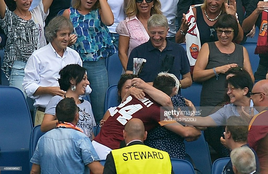 AS Roma midfielder Alessandro Florenzi hugs his grandmother as celebrates after scoring on September 21 2014 during an Italian Serie A football match...