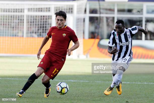 Roma midfielder Cengiz Under chased by Juventus midfielder Kwadwo Asamoah during an International Champions Cup match between AS Roma and Juventus on...