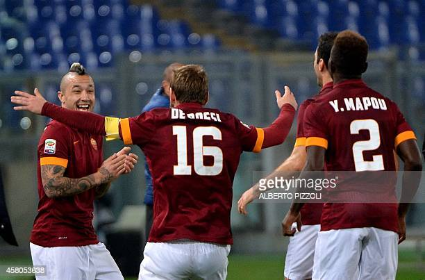 AS Roma midfielder Daniele De Rossi celebrates after scoring during the Italian Serie A football match As Roma vs Cesena on October 29 2014 at the...