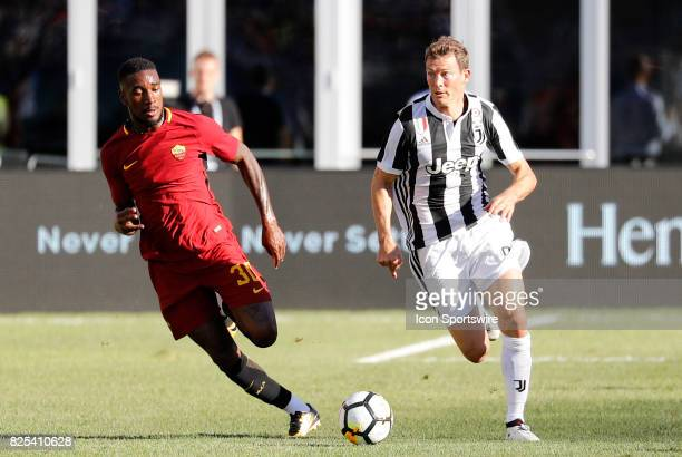 Roma midfielder Gerson chases after Juventus defender Stephan Lichtsteiner during an International Champions Cup match between AS Roma and Juventus...