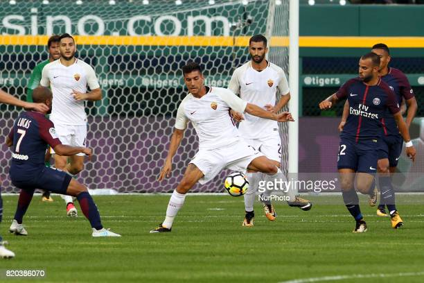 Roma midfielder Lorenzo Pellegrini brings the ball up the field under the pressure of Paris SaintGermain defense during an International Champions...