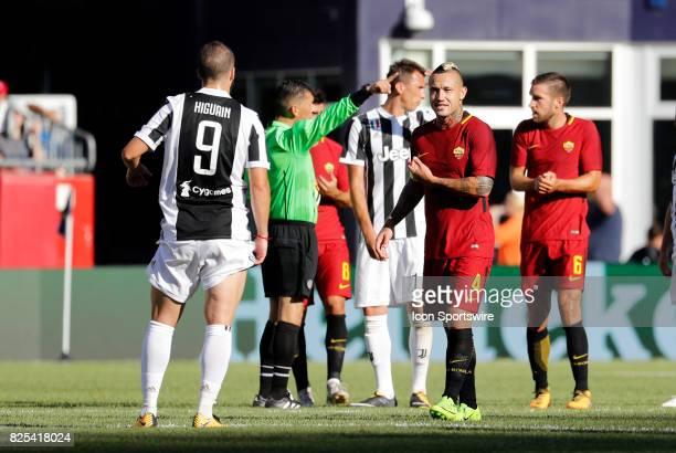 Roma midfielder Radja Nainggolan chats with Juventus forward Gonzalo Higuain during an International Champions Cup match between AS Roma and Juventus...