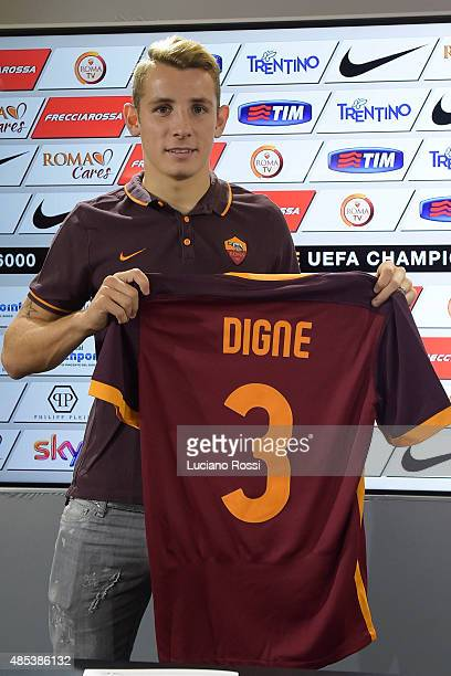 Roma new signing Lucas Digne poses with his new shirt at Centro Sportivo Fulvio Bernardini on August 27 2015 in Rome Italy