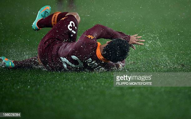 AS Roma Paraguaian defender Ivàn Rodrigo Piris slides on the pitch during the Italian Serie A football derby between Lazio Rome and AS Roma on...