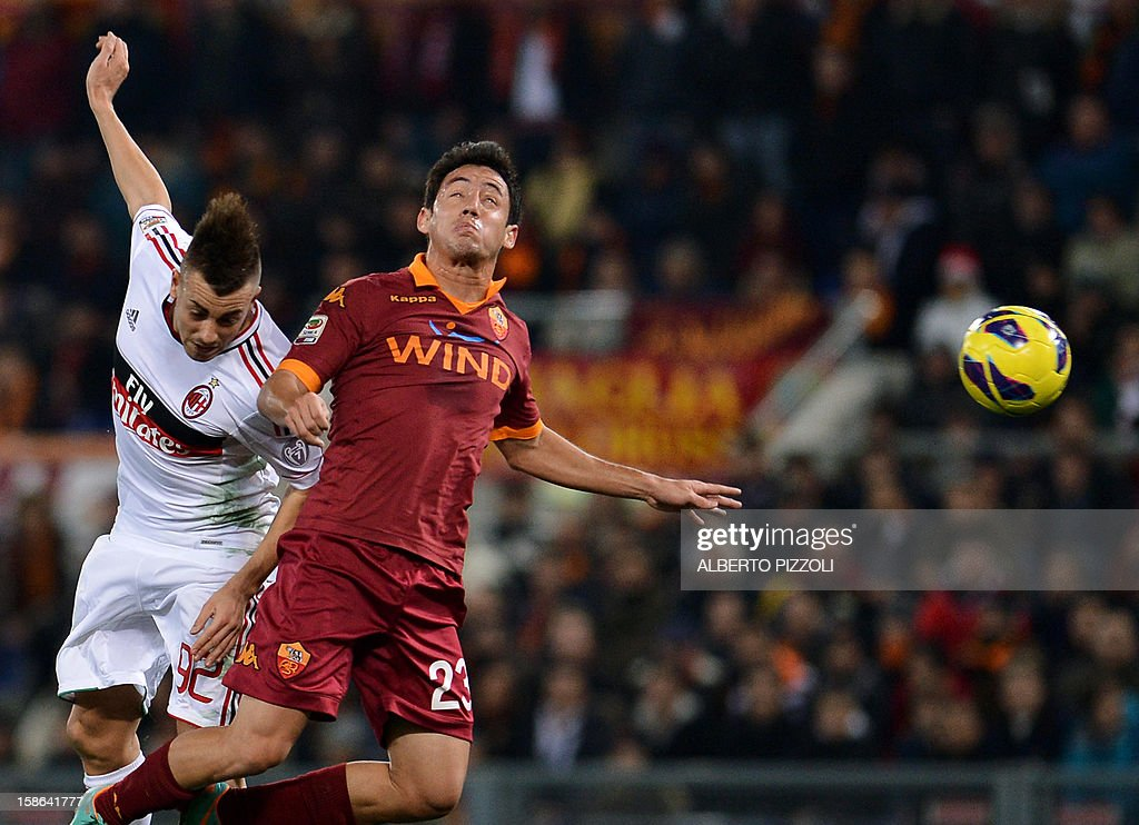 AS Roma Paraguayan defender Ivan Rodrigo Piris (R) vies for the ball with AC Milan's forward Stephan El Shaarawy during the Italian Serie A football match between AS Roma and AC Milan on December 22, 2012, at the Olympic stadium in Rome. AFP PHOTO / ALBERTO PIZZOLI