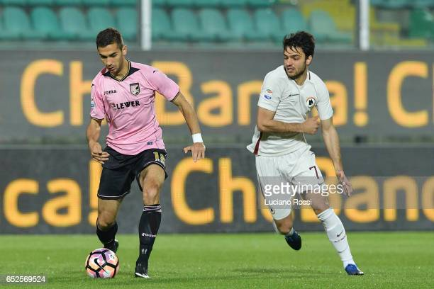 Roma player Clemente Grenier competes with US Citt di Palermo player Ivaylo Chochev during the Serie A match between US Citta di Palermo and AS Roma...