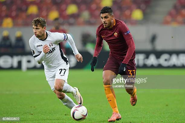 Roma player Emerson Palmieri competes with FC Astra Giurgiu player Alexandru Stan during the UEFA Europa League match between FC Astra Giurgiu and AS...
