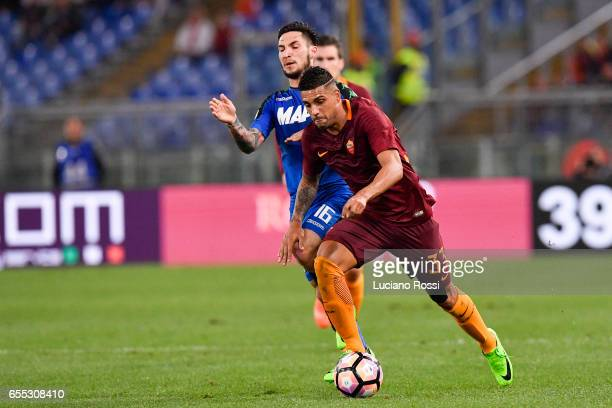 Roma player Emerson Palmieri competes with US Sassuolo player Matteo Politano during the Serie A match between AS Roma and US Sassuolo at Stadio...