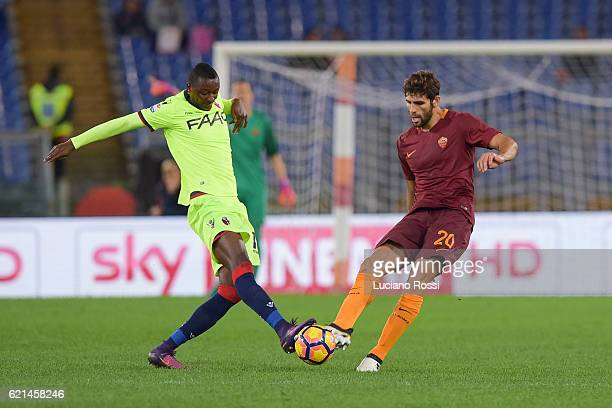 Roma player Federico Fazio competes with FC Bologna player Umar Sadiq during the Serie A match between AS Roma and Bologna FC at Stadio Olimpico on...