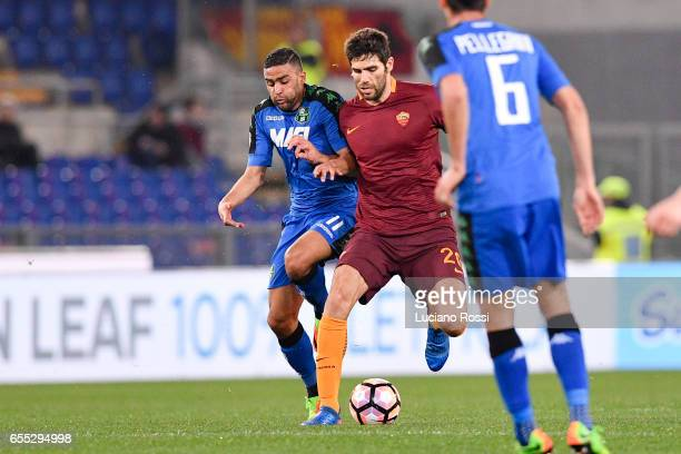 Roma player Federico Fazio competes with US Sassuolo player Gregoire Defrel during the Serie A match between AS Roma and US Sassuolo at Stadio...