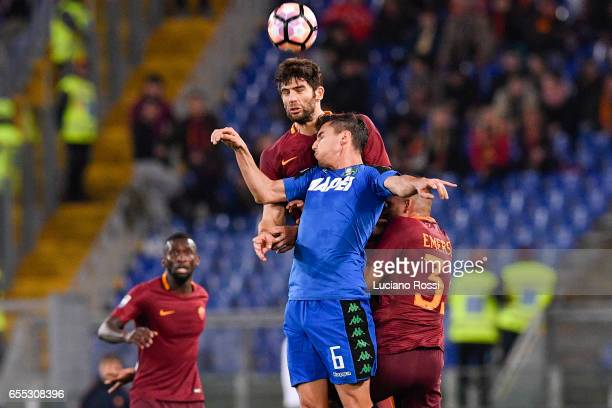 Roma player Federico Fazio competes with US Sassuolo player Lorenzo Pellegrini during the Serie A match between AS Roma and US Sassuolo at Stadio...
