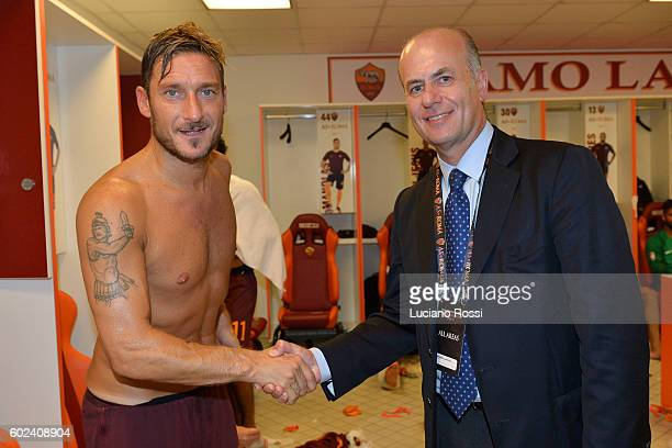 Roma player Francesco Totti and new AS Roma Ceo Roberto Gandini shakes the hands after the Serie A match between AS Roma and UC Sampdoria at Stadio...