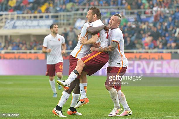 Roma player Francesco Totti celebrated by teammates Antonio Rudiger and Radja nainggolan during the Serie A match between Atalanta BC and AS Roma at...
