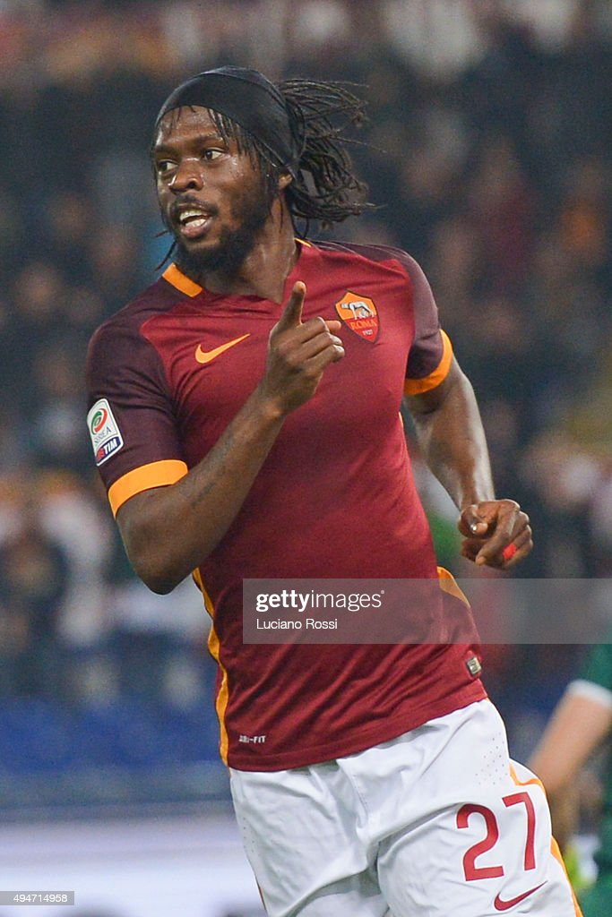 AS Roma player <a gi-track='captionPersonalityLinkClicked' href=/galleries/search?phrase=Gervinho&family=editorial&specificpeople=4500752 ng-click='$event.stopPropagation()'>Gervinho</a> (C) celebrates his goal during the Serie A match between AS Roma and Udinese Calcio at Stadio Olimpico on October 28, 2015 in Rome, Italy.