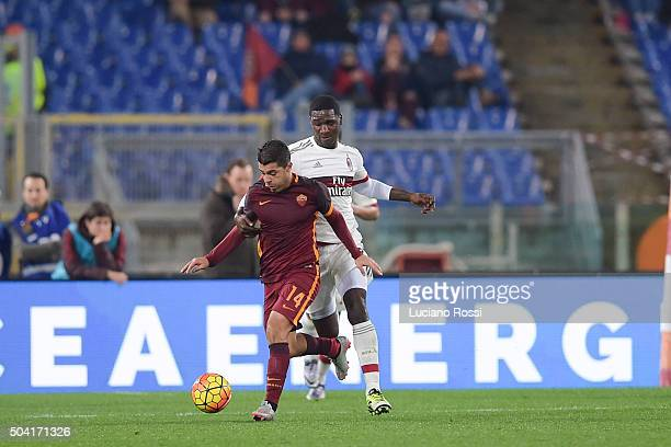 Roma player Iago Falque competes with AC Milan player Cristian Zapata during the Serie A match between AS Roma and AC Milan at Stadio Olimpico on...