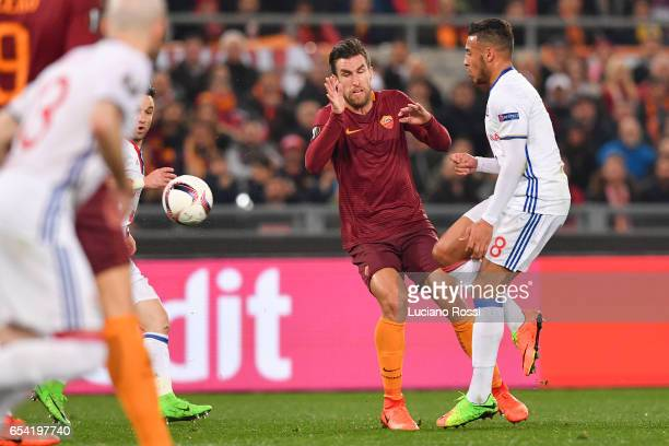 Roma player Kevin Strootman competes with Olympique Lyonnais player Corentin Tolisso during the UEFA Europa League Round of 16 second leg match...