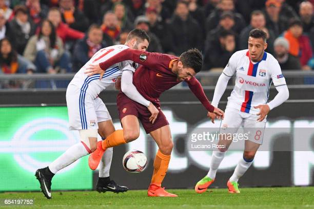 Roma player Kevin Strootman competes with Olympique Lyonnais player Maxime Gonalons during the UEFA Europa League Round of 16 second leg match...