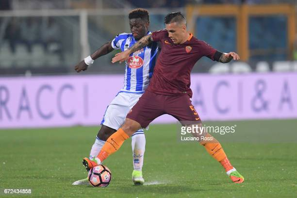 Roma player Leandro Paredes is challenged by Pescara Calcio player Sulley Muntari during the Serie A match between Pescara Calcio and AS Roma at...