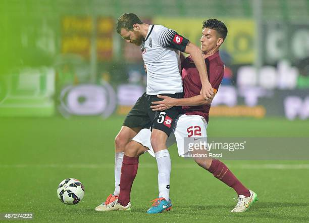 Roma player Lorenzo Pellegrini is challenged by AC Cesena player Luigi Giorgi during the Serie A match between AC Cesena and AS Roma at Dino Manuzzi...