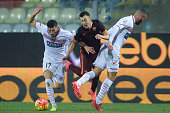 Roma player Stephan El Shaarawy is challenged by Carpi FC players Marco Crimi and Emanuele Suagher during the Serie A match between Carpi FC and AS...