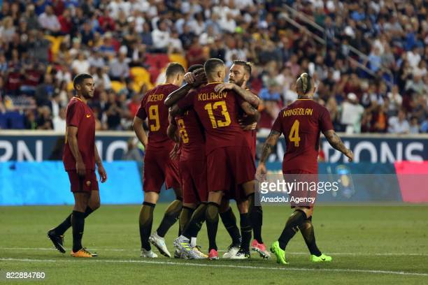 Roma players celebrate after scoring a goal during a friendly match between AS Roma and Tottenham Hotspur within International Champions Cup 2017 at...