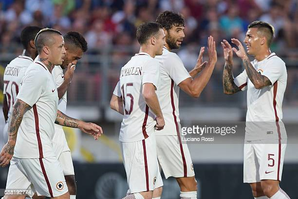 Roma players celebrate after the goal scored by Federico Fazio during the preseason friedly match between Latina and AS Roma at on August 10 2016 in...