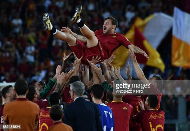 Roma players celebrate Roma's captain Francesco Totti during a ceremony following his last match with AS Roma after the Italian Serie A football...