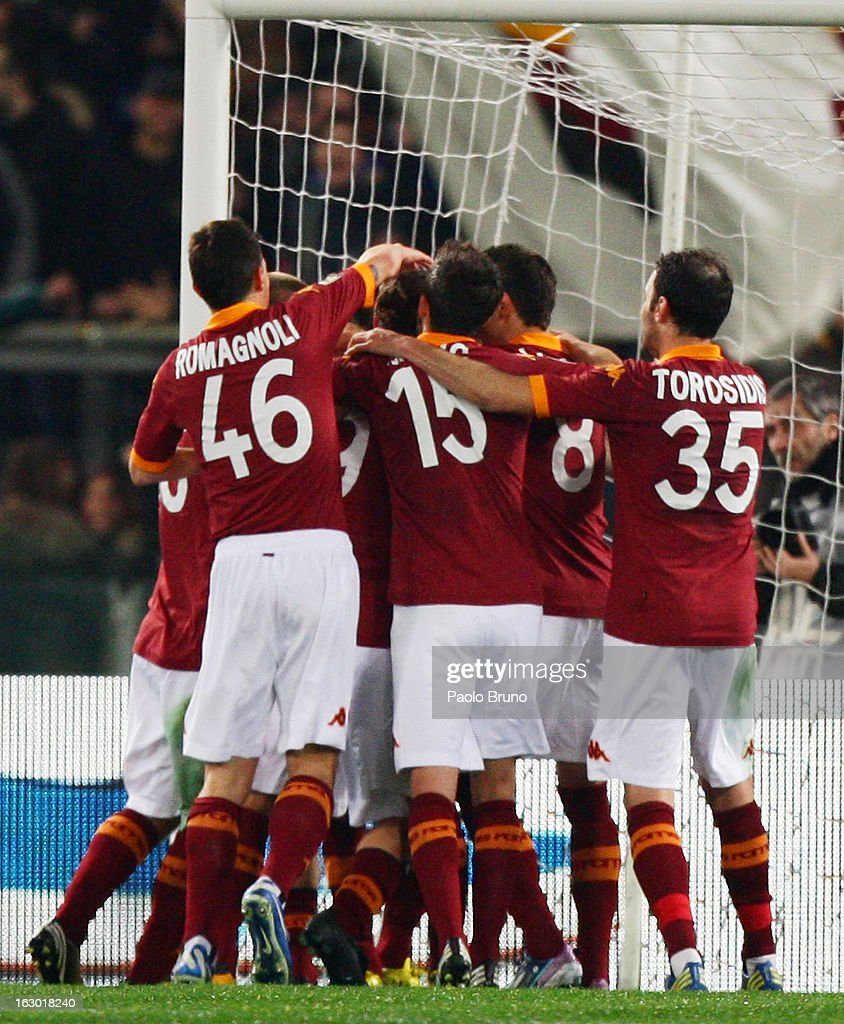 Roma players celebrate the opening goal scored by <a gi-track='captionPersonalityLinkClicked' href=/galleries/search?phrase=Francesco+Totti&family=editorial&specificpeople=208985 ng-click='$event.stopPropagation()'>Francesco Totti</a> during the Serie A match between AS Roma and Genoa CFC at Stadio Olimpico on March 3, 2013 in Rome, Italy.