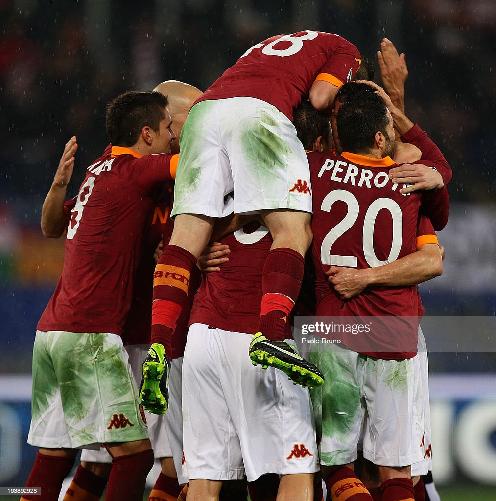 AS Roma players celebrate the second team's goal scored by Francesco Totti during the Serie A match between AS Roma and Parma FC at Stadio Olimpico on March 17, 2013 in Rome, Italy.