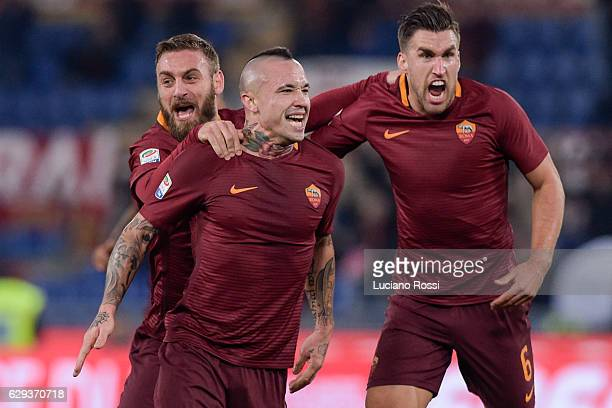 Roma players Daniele De Rossi Radja Nainggolan and Kevin Strootman celebrate during the Serie A match between AS Roma and AC Milan at Stadio Olimpico...