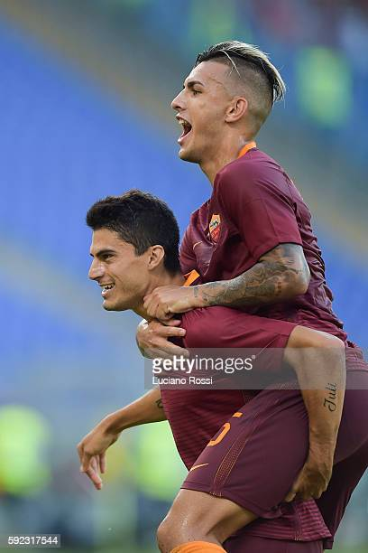 Roma players Diego Perotti and Leandro Paredes celebrate during the Serie A match between AS Roma and Udinese Calcio at Olimpico Stadium on August 20...