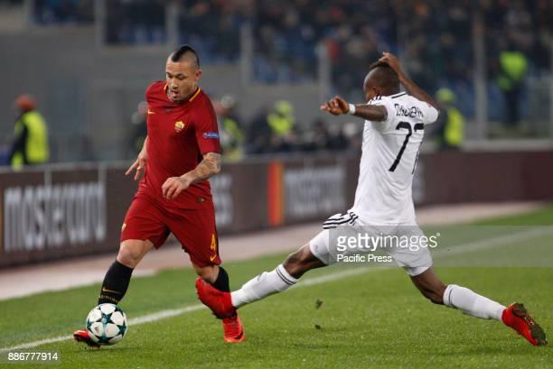 Roma Radja Nainggolan left is challenged by Qarabag Donald Guerrier during the Champions League Group C soccer match between Roma and Qarabag at the...