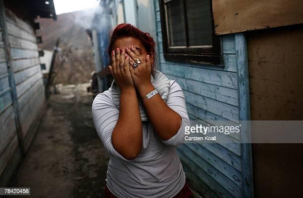 Roma refugee hides her face outside her house in the Cesmin Lug refugee camp in the Serbian district December 12 2007 in Kosovo province Serbia One...