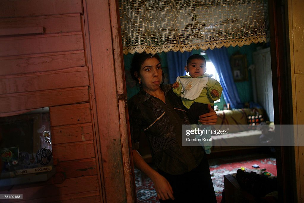 A Roma refugee holds her baby in the living room of her home in the Cesmin Lug refugee camp in the Serbian district December 12, 2007 in Kosovo province, Serbia. One hundred and fourty-four refugees live in the camp near toxic metal waste left by the Trepca mines, living in extremely poor conditions with no running water. Members of the Roma minority were forced to flee their homes in the Mahala district in southern Mitrovica during the Kosovo war in the 1999. They settled in the Serb-populated northern side of the divided province. Were independence to come to Kosovo, the north would continue as a Serbian enclave. Kosovo, administered by the United Nations since the 1990 conflict, is home to approximately 120,000 Serbs, who face an uncertain future should the province, with its majority Albanian population, become independent under a U.N. proposed plan.