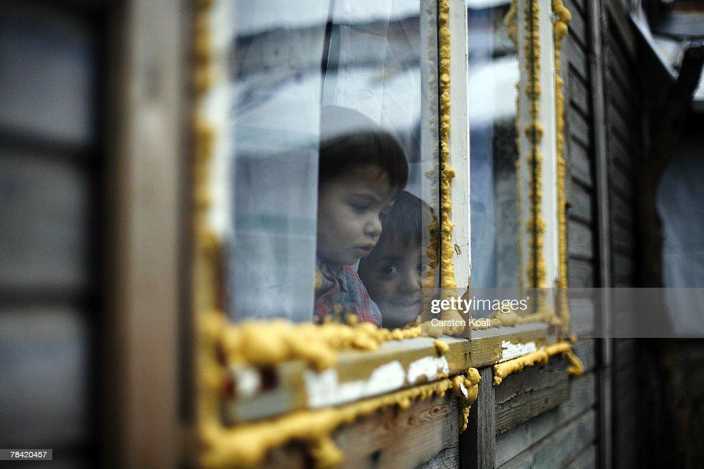 A Roma refugee looks out of a window in his house in the Cesmin Lug refugee camp in the Serbian district December 12, 2007 in Kosovo province, Serbia. One hundred and fourty-four refugees live in the camp near toxic metal waste left by the Trepca mines, living in extremely poor conditions with no running water. Members of the Roma minority were forced to flee their homes in the Mahala district in southern Mitrovica during the Kosovo war in the 1999. They settled in the Serb-populated northern side of the divided province. Were independence to come to Kosovo, the north would continue as a Serbian enclave. Kosovo, administered by the United Nations since the 1990 conflict, is home to approximately 120,000 Serbs, who face an uncertain future should the province, with its majority Albanian population, become independent under a U.N. proposed plan.