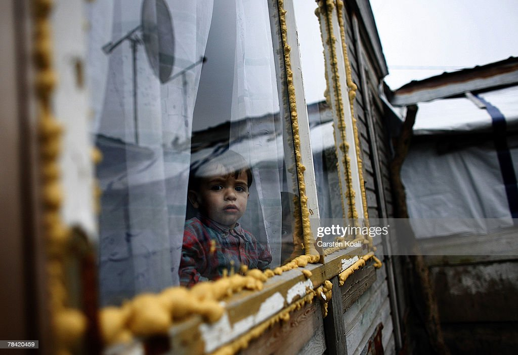 A Roma refugee looks through a window in his house in the Cesmin Lug refugee camp in the Serbian district December 12, 2007 in Kosovo province, Serbia. One hundred and fourty-four refugees live in the camp near toxic metal waste left by the Trepca mines, living in extremely poor conditions with no running water. Members of the Roma minority were forced to flee their homes in the Mahala district in southern Mitrovica during the Kosovo war in the 1999. They settled in the Serb-populated northern side of the divided province. Were independence to come to Kosovo, the north would continue as a Serbian enclave. Kosovo, administered by the United Nations since the 1990 conflict, is home to approximately 120,000 Serbs, who face an uncertain future should the province, with its majority Albanian population, become independent under a U.N. proposed plan.
