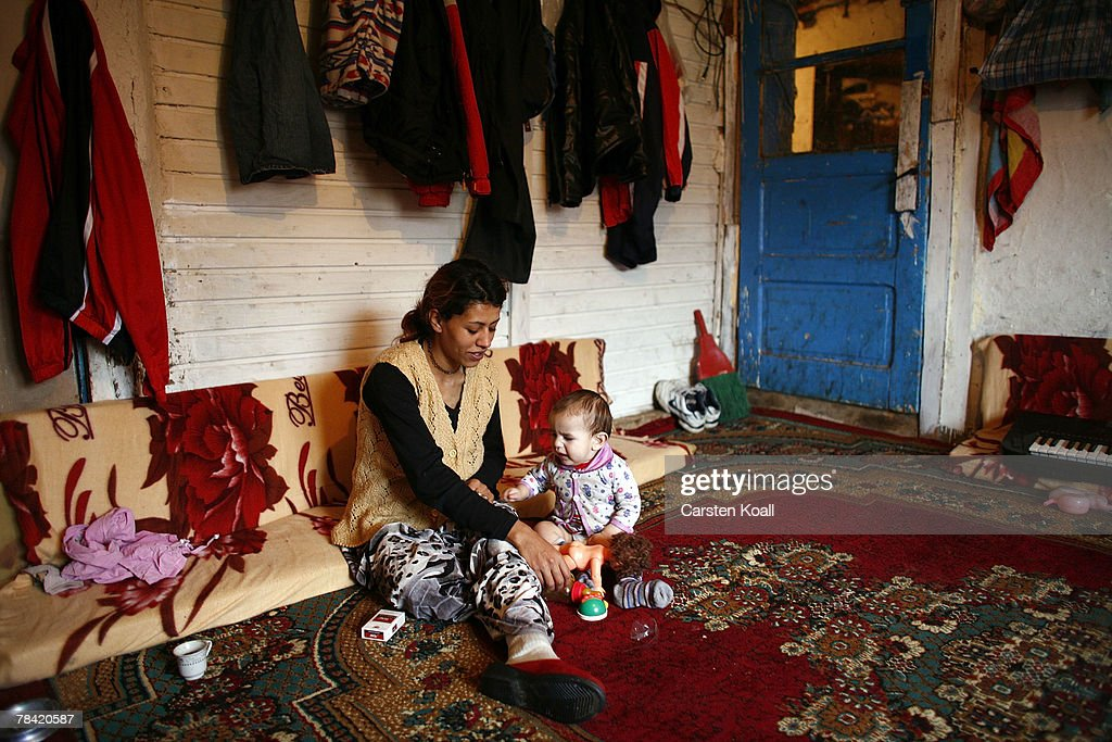Roma refugee Rifadije Smajl sits with her eight-month old baby Sabit on the floor in their house in the Cesmin Lug refugee camp in the Serbian district December 12, 2007 in Kosovo province, Serbia. One hundred and fourty-four refugees live in the camp near toxic metal waste left by the Trepca mines, living in extremely poor conditions with no running water. Members of the Roma minority were forced to flee their homes in the Mahala district in southern Mitrovica during the Kosovo war in the 1999. They settled in the Serb-populated northern side of the divided province. Were independence to come to Kosovo, the north would continue as a Serbian enclave. Kosovo, administered by the United Nations since the 1990 conflict, is home to approximately 120,000 Serbs, who face an uncertain future should the province, with its majority Albanian population, become independent under a U.N. proposed plan.
