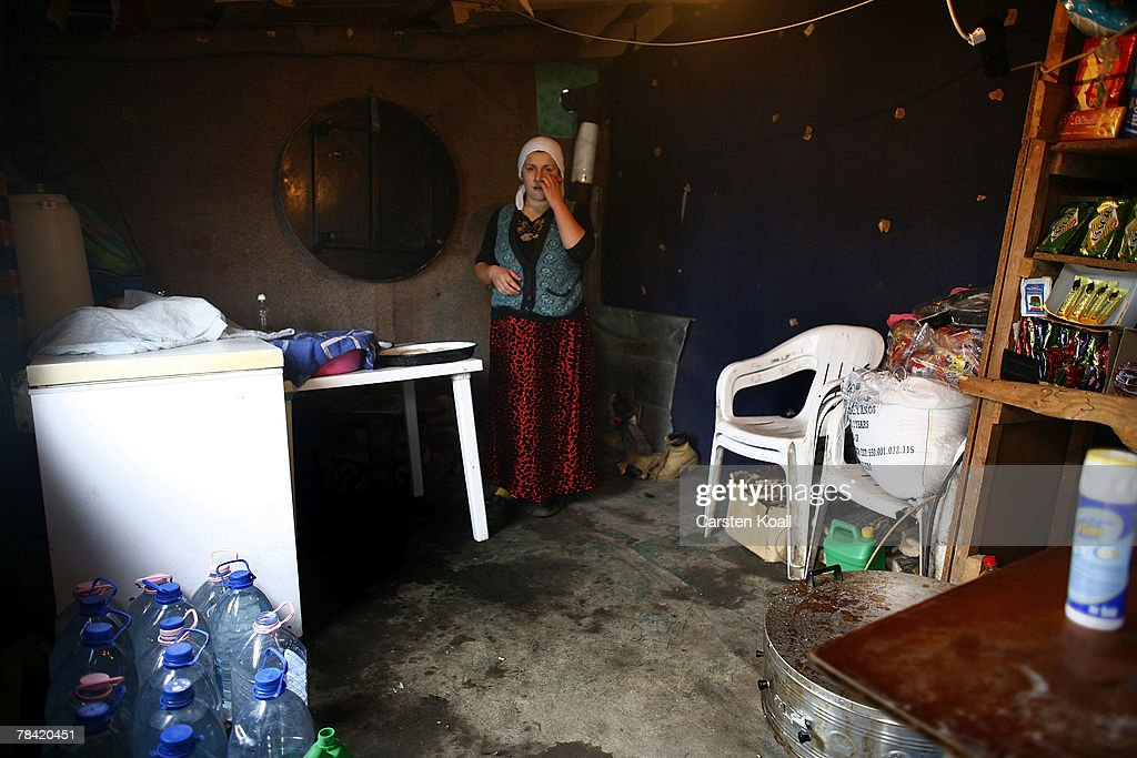 A Roma refugee stands in her house in the Cesmin Lug refugee camp in the Serbian district December 12, 2007 in Kosovo province, Serbia. One hundred and fourty-four refugees live in the camp near toxic metal waste left by the Trepca mines, living in extremely poor conditions with no running water. Members of the Roma minority were forced to flee their homes in the Mahala district in southern Mitrovica during the Kosovo war in the 1999. They settled in the Serb-populated northern side of the divided province. Were independence to come to Kosovo, the north would continue as a Serbian enclave. Kosovo, administered by the United Nations since the 1990 conflict, is home to approximately 120,000 Serbs, who face an uncertain future should the province, with its majority Albanian population, become independent under a U.N. proposed plan.