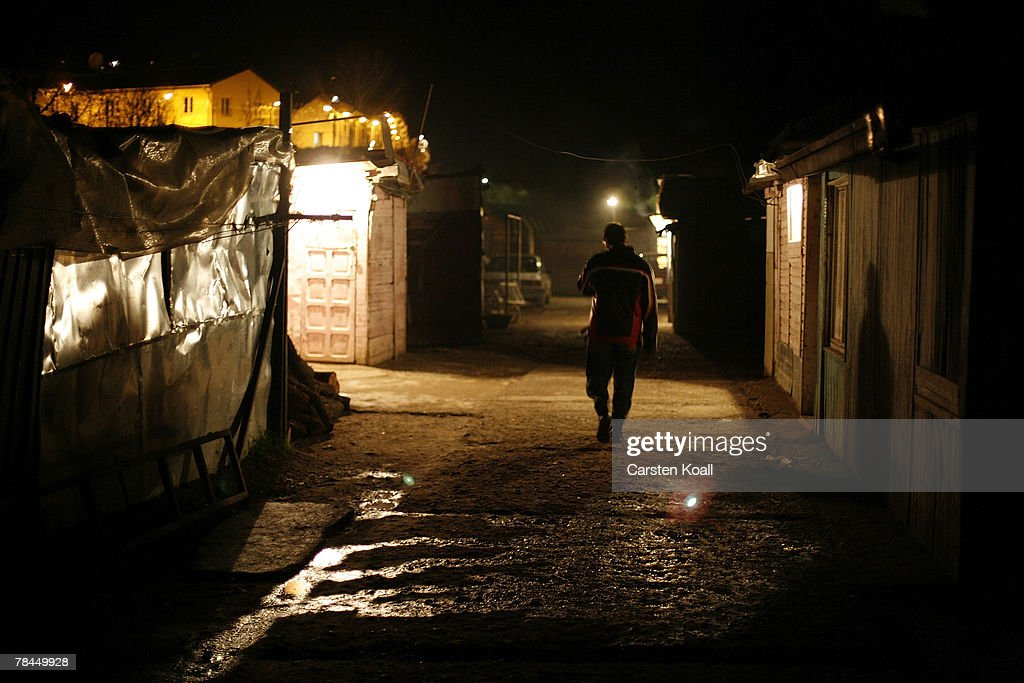 A Roma refugee walks in the night on the way to the Cesmin Lug refugee camp in the Serbian district December 12, 2007 in Kosovo province, Serbia. 144 refugees live there near toxic metal waste left by the Trepca mines in bed living in extremely poor conditions with no running water or toilets. Roma people were forced to move to the Serb populated northern side of the divided province when their houses were burned out in the Mahala. Were independence to come to Kosovo, the north would continue as a Serbian enclave. Kosovo, administered by the United Nations since the 1990 conflict, is home to approximately 120,00 Serbs, who face an uncertain future should the province, with its majority Albanian population, become independent under a U.N. proposed plan.