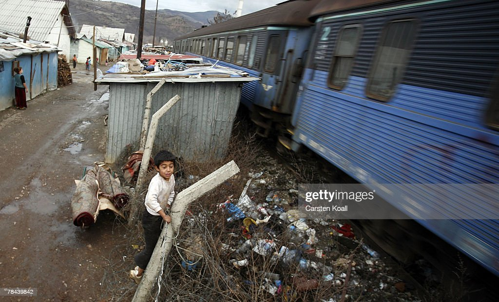 A Roma refugee watches a passing train in the Cesmin Lug refugee camp in the Serbian district December 12, 2007 in Kosovo province, Serbia. One hundred and fourty-four refugees live in the camp near toxic metal waste left by the Trepca mines, living in extremely poor conditions with no running water. Members of the Roma minority were forced to flee their homes in the Mahala district in southern Mitrovica during the Kosovo war in the 1999. They settled in the Serb-populated northern side of the divided province. Were independence to come to Kosovo, the north would continue as a Serbian enclave. Kosovo, administered by the United Nations since the 1990 conflict, is home to approximately 120,000 Serbs, who face an uncertain future should the province, with its majority Albanian population, become independent under a U.N. proposed plan.