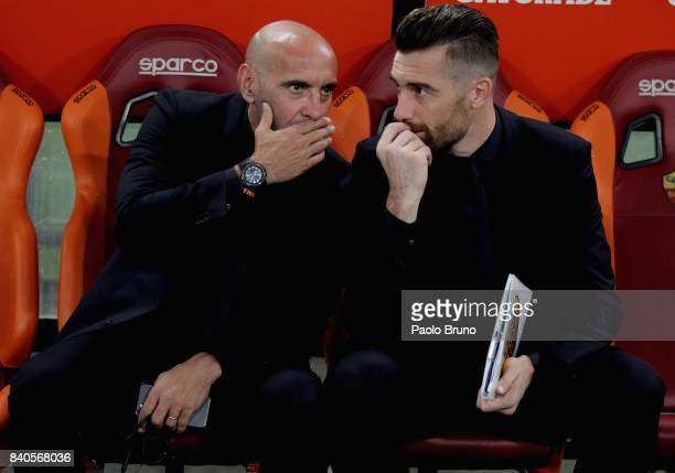 AS Roma Sport Director Monchi and Team Manager Morgan De Sanctis speak during the Serie A match between AS Roma and FC Internazionale on August 26...