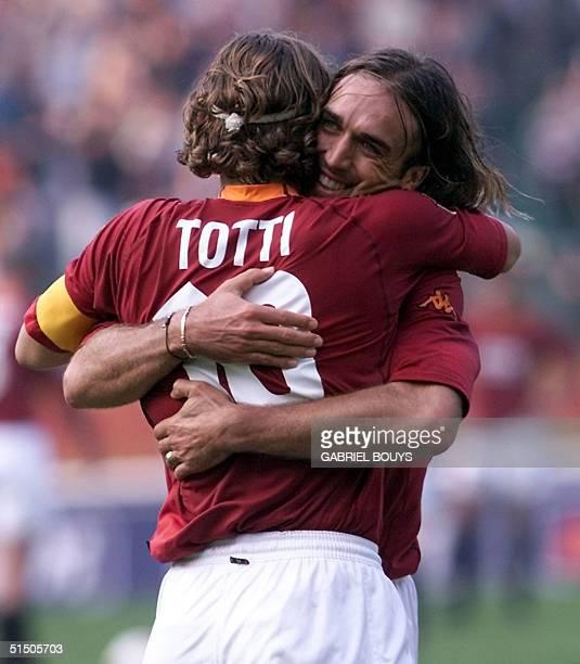 Roma striker Gabriel Batistuta is congratulaed by his captain Francesco Totti after he scores a goal agaisnt Vicenza during their Italian first...