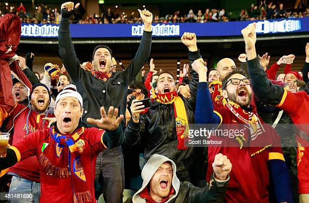 Roma supporters celebrate as their team scores a goal during the International Champions Cup match between Manchester City and AS Roma at the...