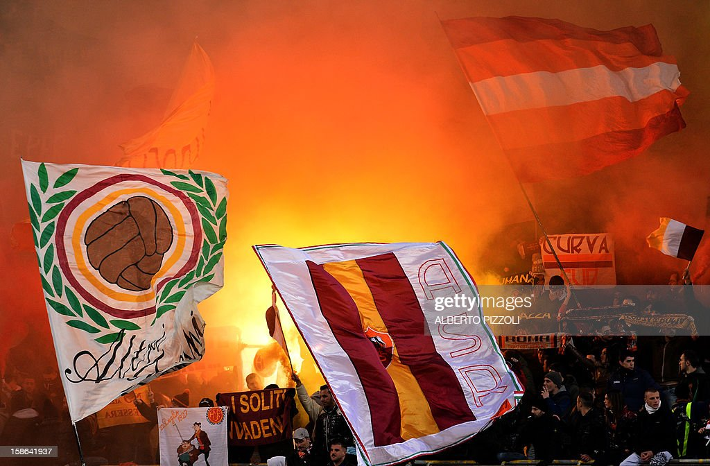 AS Roma supporters cheer their team during the Italian Serie A football match between AS Roma and AC Milan on December 22, 2012, at the Olympic stadium in Rome.
