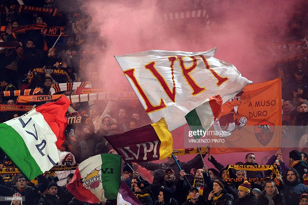AS Roma supporters cheer their team during the Italy's Cup semifinal football match AS Roma vs Inter on January 23, 2013 at the Olympic stadium in Rome. AFP PHOTO / VINCENZO PINTO