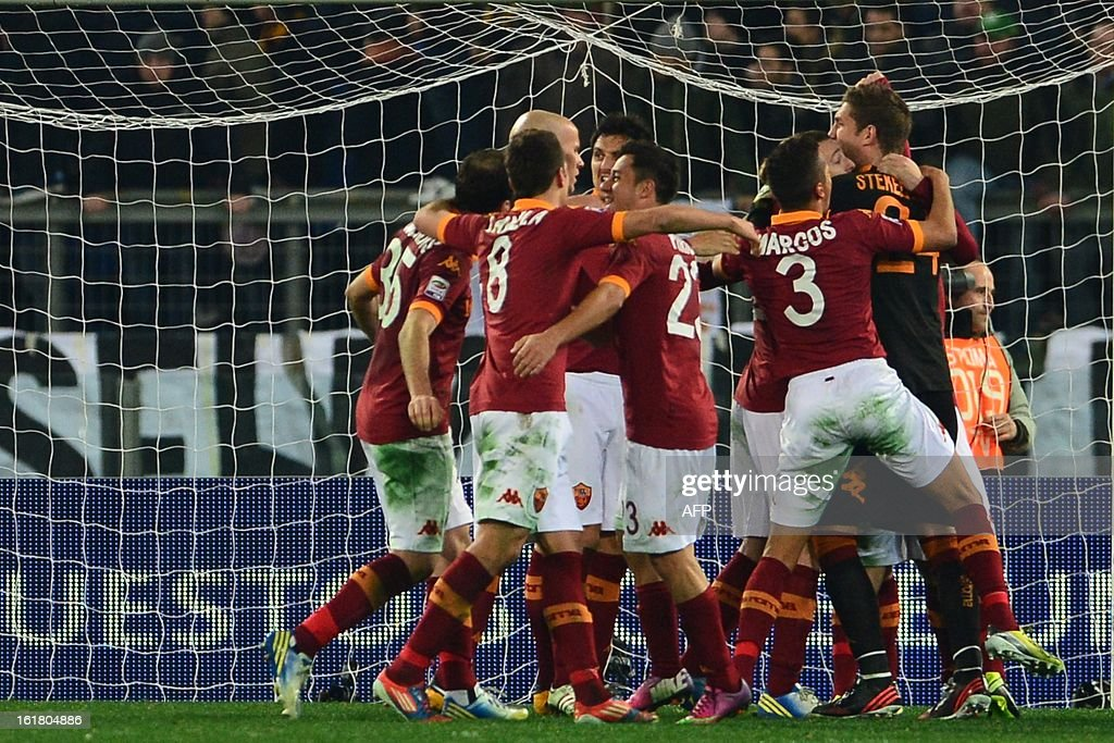 AS Roma team celebrate at the end of the Italian Serie A football match between AS Roma and Juventus on February 16, 2013 at the Olympic Stadium in Rome. AS Roma defeated Juventus 1-0.