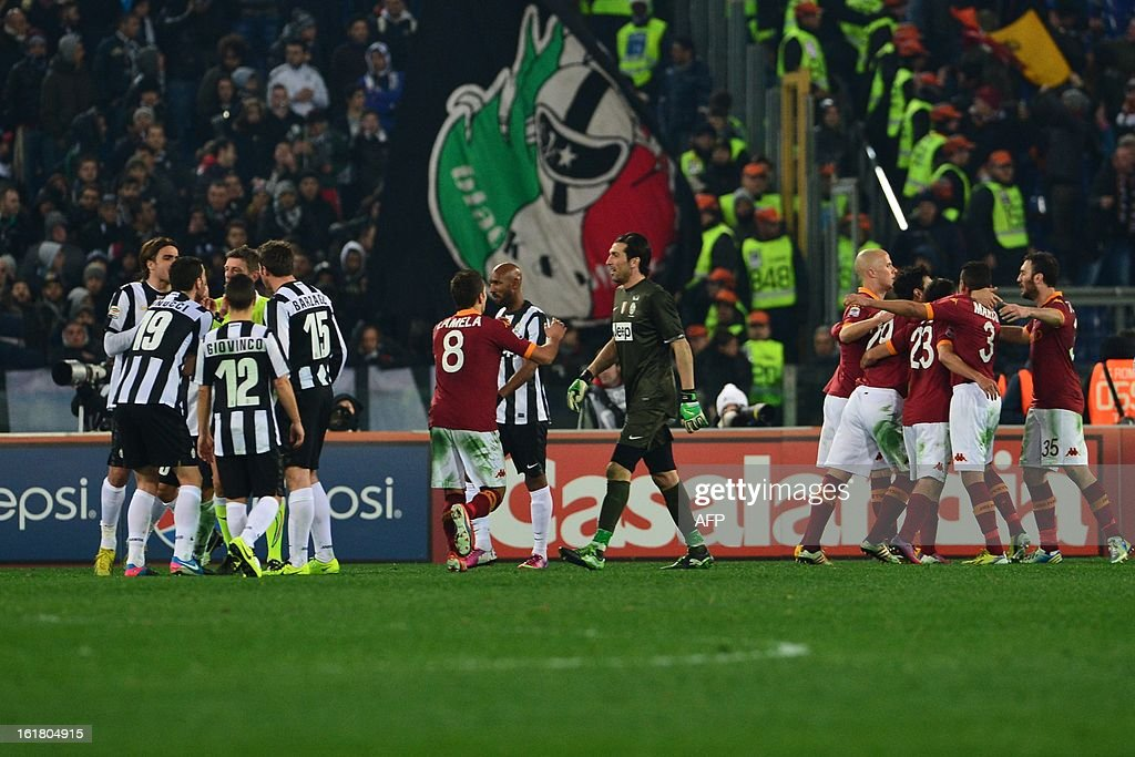 AS Roma team celebrates at the end of the Italian Serie A football match between AS Roma and Juventus on February 16, 2013 at the Olympic Stadium in Rome. AS Roma defeated Juventus 1-0.